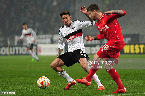 Liverpool's Alberto Moreno vies for the ball with Besiktas' Jose Sosa during the secondleg Round of 32 UEFA Europa League football match Besiktas vs...