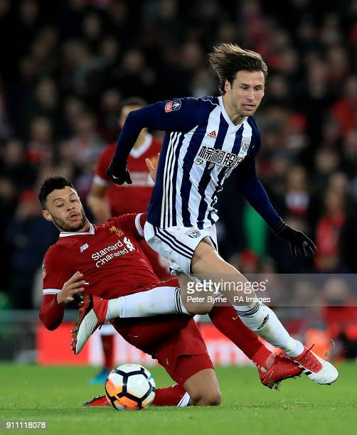 Liverpool's Alex OxladeChamberlain and West Bromwich Albion's Grzegorz Krychowiak battle for the ball during the Emirates FA Cup fourth round match...