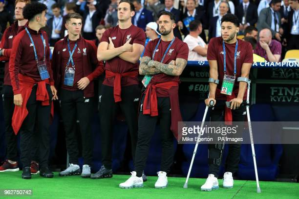 Liverpool's Alex OxladeChamberlain on crutches due to a knee injury during the UEFA Champions League Final at the NSK Olimpiyskiy Stadium Kiev