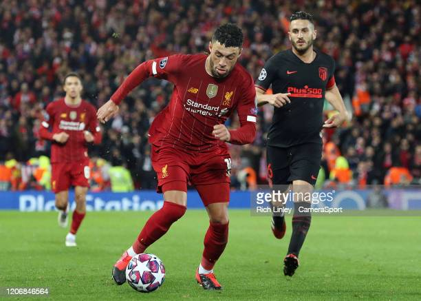 Liverpool's Alex OxladeChamberlain under pressure from Atletico Madrid's Koke during the UEFA Champions League round of 16 second leg match between...