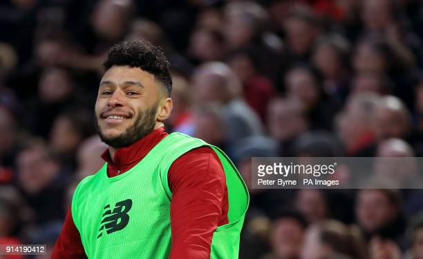 Liverpool's Alex OxladeChamberlain warms up on the touchline during the Premier League match at Anfield Liverpool