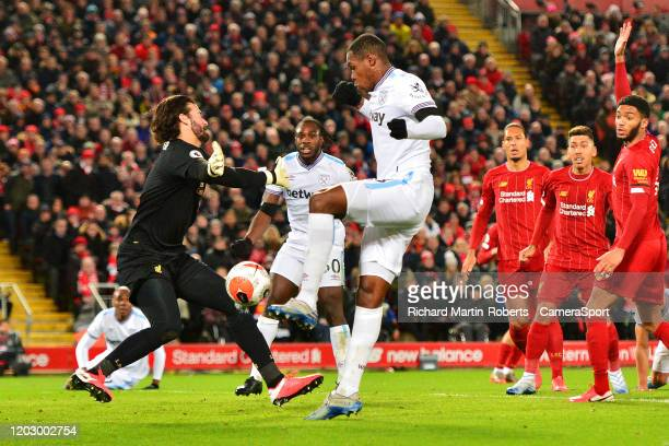 Liverpool's Alisson Becker blocks the attempt on goal of West Ham United's Issa Diop during the Premier League match between Liverpool FC and West...