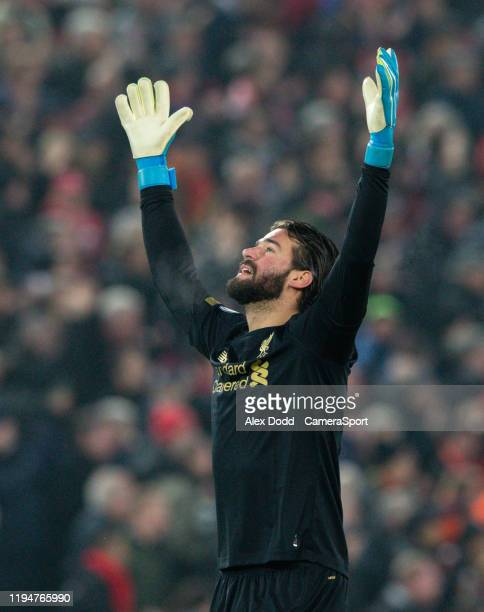 Liverpool's Alisson Becker celebrates his side's opening goal during the Premier League match between Liverpool FC and Manchester United at Anfield...