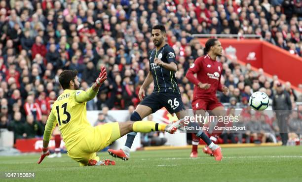 Liverpool's Alisson Becker denies Manchester City's Riyad Mahrez but the attack was ruled offside anyway during the Premier League match between...