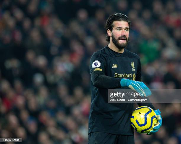 Liverpool's Alisson Becker gestures during the Premier League match between Liverpool FC and Manchester United at Anfield on January 19 2020 in...