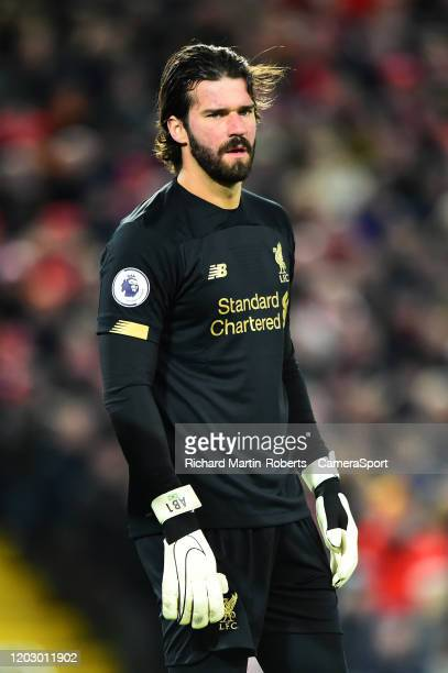 Liverpool's Alisson Becker looks on during the Premier League match between Liverpool FC and West Ham United at Anfield on February 24 2020 in...