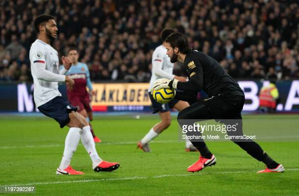 Liverpool's Alisson Becker saves a shot on goal during the Premier League match between West Ham United and Liverpool FC at London Stadium on January...