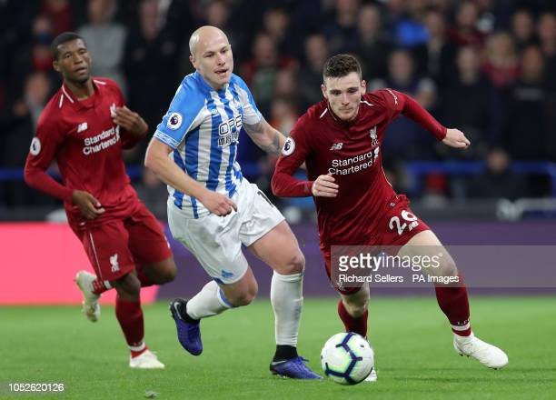Liverpool's Andrew Robertson and Huddersfield Town's Aaron Mooy during the Premier League match at the John Smith's Stadium Huddersfield