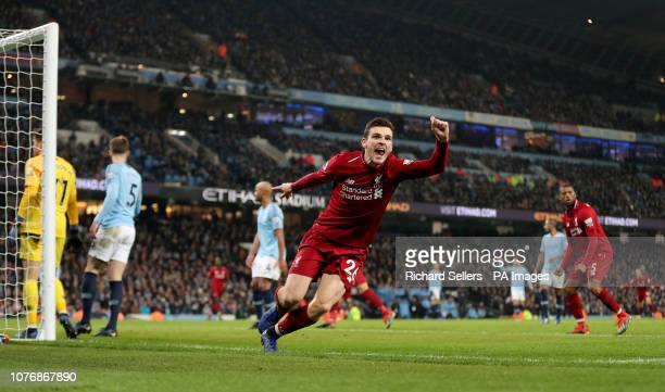 Liverpool's Andrew Robertson celebrates after team-mate Liverpool's Roberto Firmino scores his side's first goal of the game during the Premier...