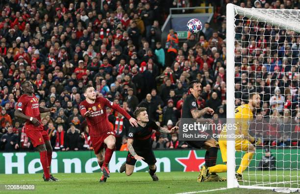 Liverpool's Andrew Robertson's headed effort hits the crossbar during the UEFA Champions League round of 16 second leg match between Liverpool FC and...