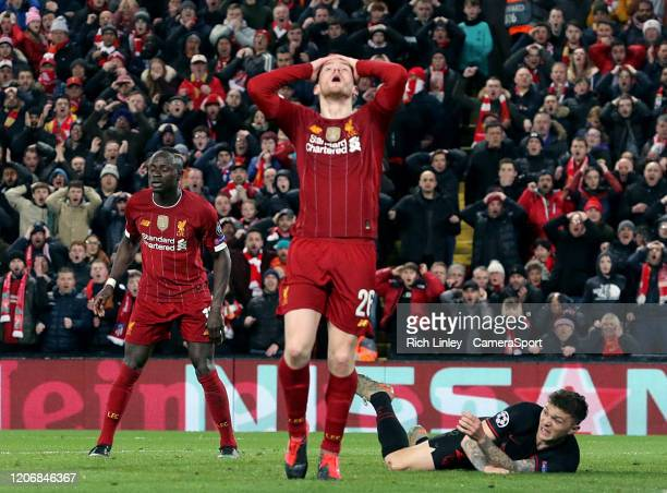 Liverpool's Andrew Robertson's reacts after his headed effort hit the crossbar during the UEFA Champions League round of 16 second leg match between...
