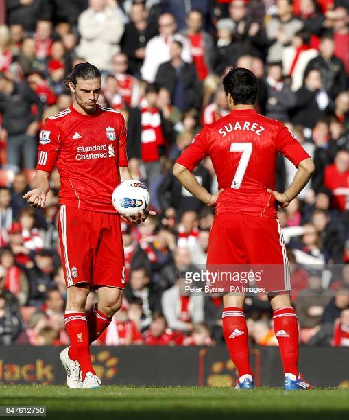 Liverpool's Andy Carroll and Luis Suarez wait to kickoff after West Bromwich Albion's Peter Odemwingie scored his team's opening goal