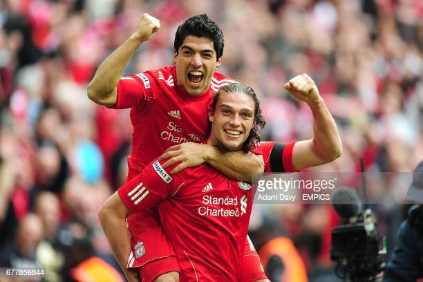 Liverpool's Andy Carroll celebrates scoring the winning goal with teammate Luis Suarez