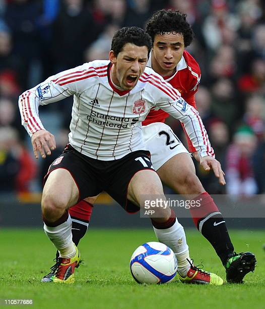 Liverpool's Argentine midfielder Maxi Rodríguez vies with Manchester United's Brazilian defender Rafael Da Silva during the FA Cup third round...