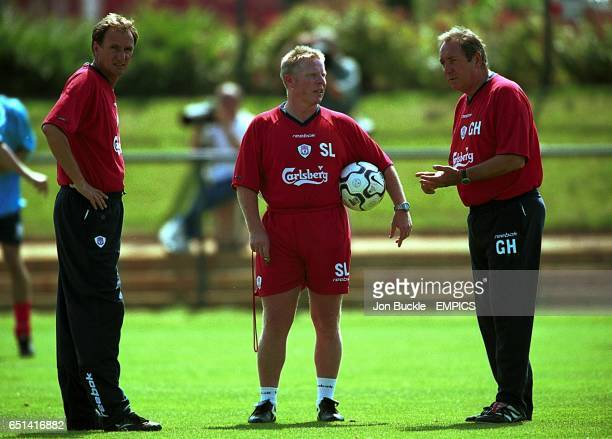Liverpool's assistant manager Phil Thompson, coach Sammy Lee and manager Gerard Houllier discuss tactics during pre-season training at The Acadamy