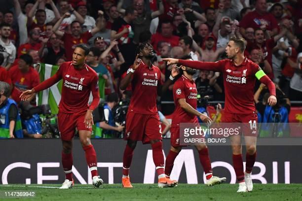 Liverpool's Belgian forward Divock Origi celebrates after scoring his team's second goal during the UEFA Champions League final football match...