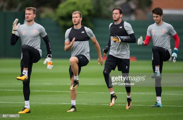 Liverpool's Belgian goalkeeper Simon Mignolet Liverpool's Estonian defender Ragnar Klavan and Liverpool's Welsh goalkeeper Danny Ward attend a team...