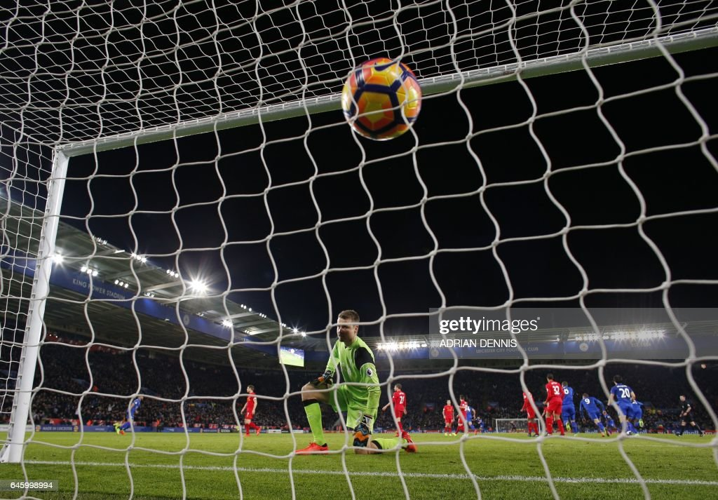 TOPSHOT - Liverpool's Belgian goalkeeper Simon Mignolet looks on after Leicester City's English midfielder Danny Drinkwater scored his team's second goal during the English Premier League football match between Leicester City and Liverpool at King Power Stadium in Leicester, central England on February 27, 2017. / AFP PHOTO / ADRIAN DENNIS / RESTRICTED TO EDITORIAL USE. No use with unauthorized audio, video, data, fixture lists, club/league logos or 'live' services. Online in-match use limited to 75 images, no video emulation. No use in betting, games or single club/league/player publications. /