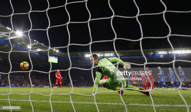 Liverpool's Belgian goalkeeper Simon Mignolet looks on after Leicester City's English midfielder Danny Drinkwater scored his team's second goal...