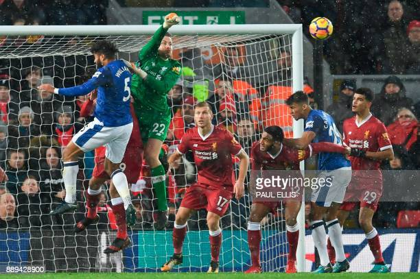 Liverpool's Belgian goalkeeper Simon Mignolet punches the ball clear from a corner during the English Premier League football match between Liverpool...