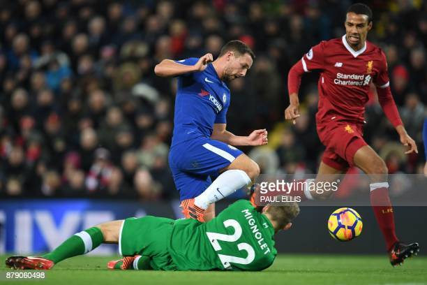 Liverpool's Belgian goalkeeper Simon Mignolet saves at the feet of Chelsea's English midfielder Danny Drinkwater during the English Premier League...