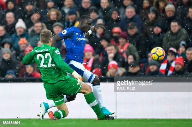 Liverpool's Belgian goalkeeper Simon Mignolet tackles Everton's Senegalese striker Oumar Niasse during the English Premier League football match...