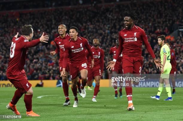 Liverpool's Belgian striker Divock Origi celebrates after scoring their fourth goal during the UEFA Champions league semifinal second leg football...