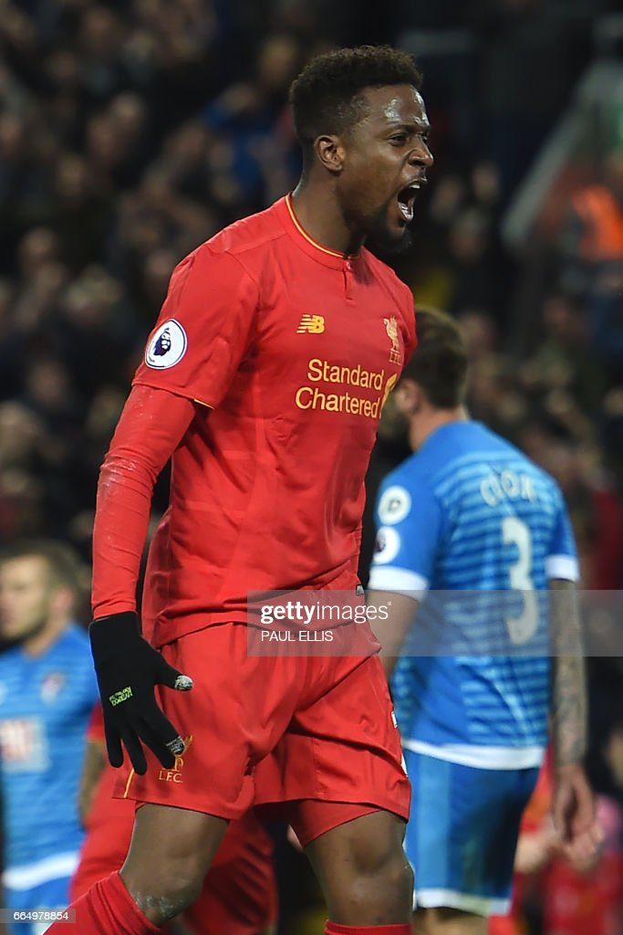 Liverpool's Belgian striker Divock Origi celebrates after scoring their second goal during the English Premier League football match between Liverpool and Bournemouth at Anfield in Liverpool, north west England on April 5, 2017. / AFP PHOTO / PAUL ELLIS / RESTRICTED TO EDITORIAL USE. No use with unauthorized audio, video, data, fixture lists, club/league logos or 'live' services. Online in-match use limited to 75 images, no video emulation. No use in betting, games or single club/league/player publications. /