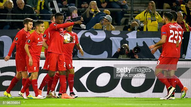 Liverpool's Belgian striker Divock Origi celebrates with teammates after scoring during the UEFA Europe League quarterfinal firstleg football match...