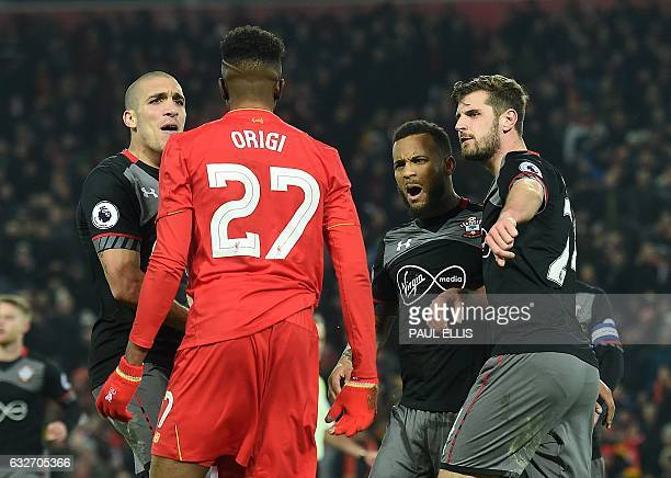 Liverpool's Belgian striker Divock Origi remonstrates with Southampton's Sepanish midfielder Oriol Romeu after he was tackled by Southampton's...