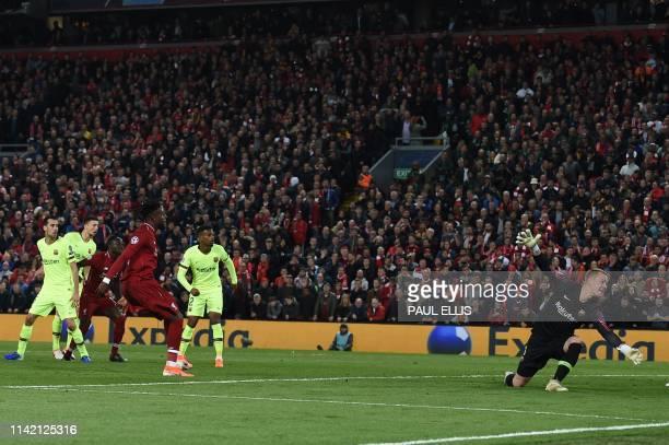Liverpool's Belgian striker Divock Origi scores their fourth goal during the UEFA Champions league semifinal second leg football match between...