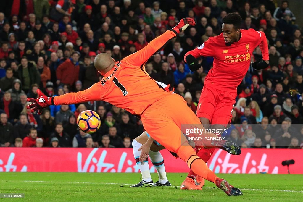 Liverpool's Belgian striker Divock Origi (R) scores their second goal to equalise during the English Premier League football match between Liverpool and West Ham United at Anfield in Liverpool, north west England on December 11, 2016. / AFP / Lindsey PARNABY / RESTRICTED TO EDITORIAL USE. No use with unauthorized audio, video, data, fixture lists, club/league logos or 'live' services. Online in-match use limited to 75 images, no video emulation. No use in betting, games or single club/league/player publications. /