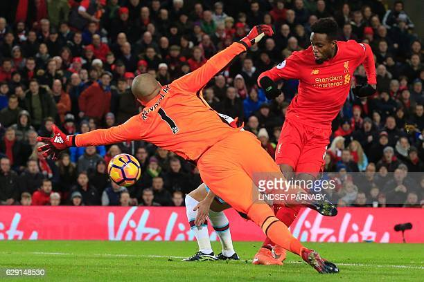 Liverpool's Belgian striker Divock Origi scores their second goal to equalise during the English Premier League football match between Liverpool and...