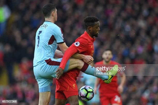 Liverpool's Belgian striker Divock Origi vies with Burnley's English defender Michael Keane during the English Premier League football match between...