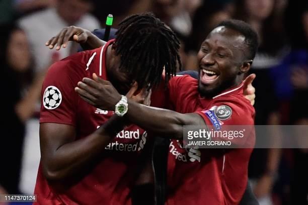 TOPSHOT Liverpool's Belgium striker Divock Origi and Liverpool's Guinean midfielder Naby Keita celebrate after winning the UEFA Champions League...