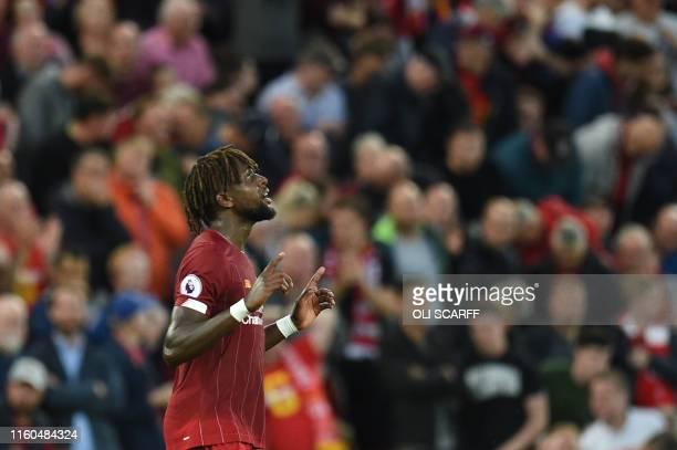 Liverpool's Belgium striker Divock Origi celebrates after he scores the team's fourth goal during the English Premier League football match between...