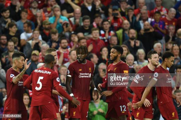 Liverpool's Belgium striker Divock Origi celebrates with teammates after he scores the team's fourth goal during the English Premier League football...