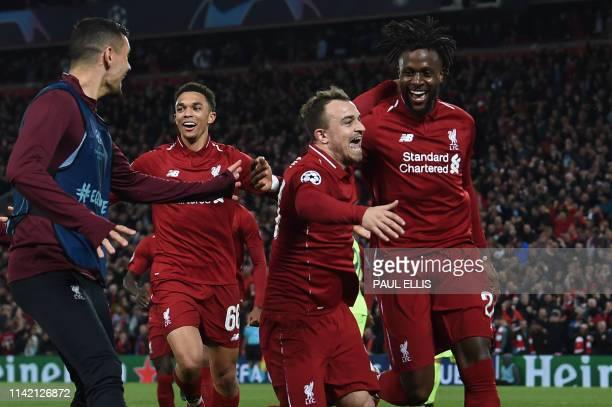 Liverpool's Belgium striker Divock Origi celebrates wtih Liverpool's Swiss midfielder Xherdan Shaqiri after scoring their fourth goal during the UEFA...