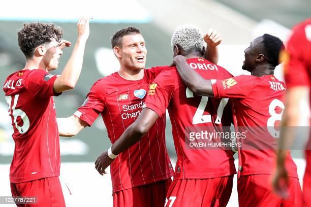 Liverpool's Belgium striker Divock Origi is congratulated by teammates after scoring a goal during the English Premier League football match between...
