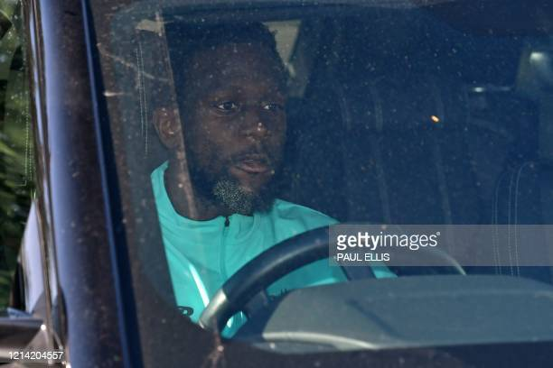 Liverpool's Belgium striker Divock Origi leaves from Liverpool's training ground at Melwood in Liverpool north west England on May 20 as training...