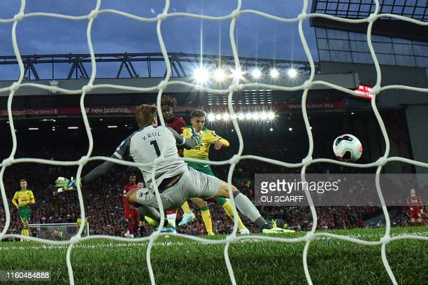 Liverpool's Belgium striker Divock Origi scores the team's fourth goal during the English Premier League football match between Liverpool and Norwich...