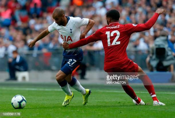 Liverpool's Belgium striker Divock Origi vies with Liverpool's English defender Joe Gomez during the English Premier League football match between...