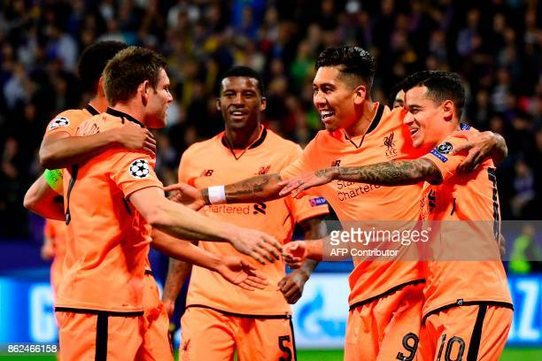 Liverpool's Brazilian forward Roberto Firmino celebrates with teammates after scoring a goal during the UEFA Champions League group E football match...