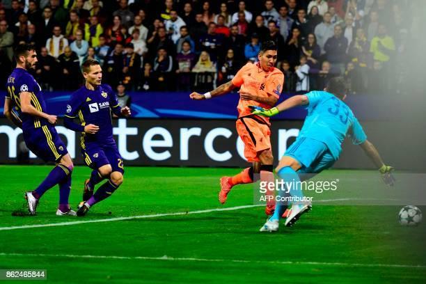Liverpool's Brazilian forward Roberto Firmino shoots and scores a goal past Maribor's Slovenian goalkeeper Jasmin Handanovic during the UEFA...