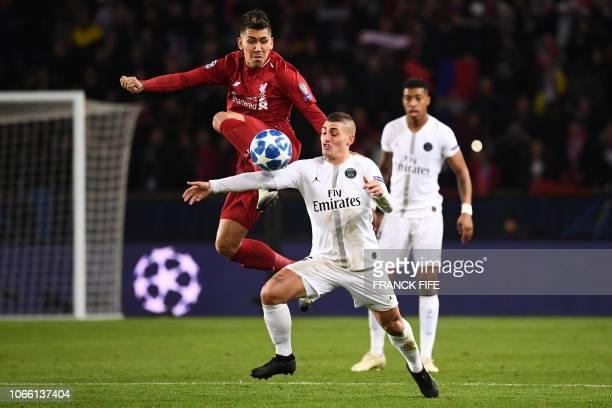 Liverpool's Brazilian forward Roberto Firmino vies for the ball with Paris SaintGermain's Italian midfielder Marco Verratti during the UEFA Champions...