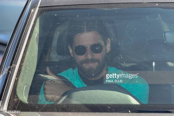 Liverpool's Brazilian goalkeeper Alisson Becker arrives at Melwood in Liverpool, north west England to resume training on May 20 as training resumes...