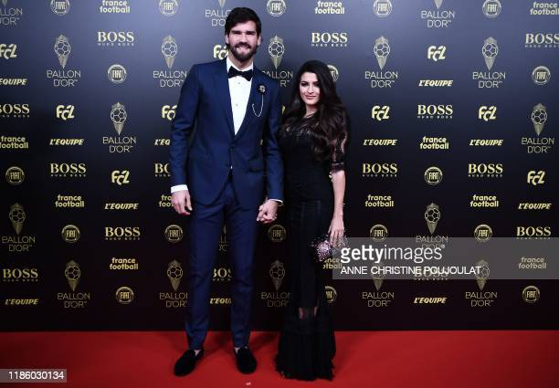 Liverpool's Brazilian goalkeeper Alisson Becker arrives to attend the Ballon d'Or France Football 2019 ceremony at the Chatelet Theatre in Paris on...