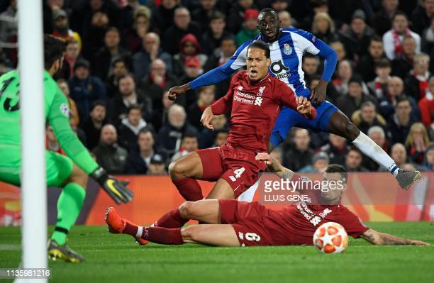 Liverpool's Brazilian goalkeeper Alisson Becker catches the ball after Porto's Malian striker Moussa Marega shoots it while vying with Liverpool's...
