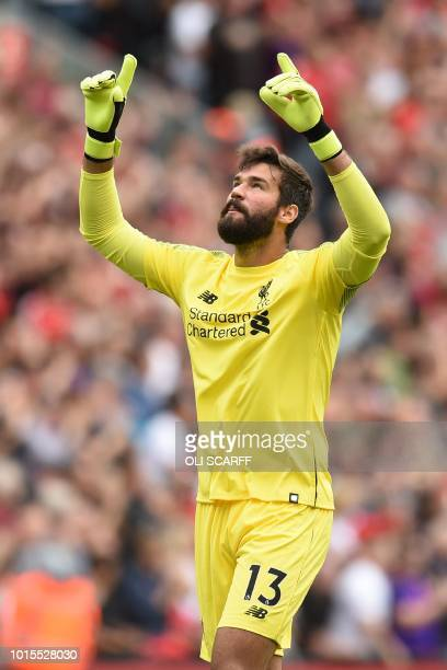 Liverpool's Brazilian goalkeeper Alisson Becker celebrates after Liverpool score their second goal during the English Premier League football match...