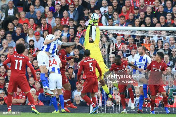 Liverpool's Brazilian goalkeeper Alisson Becker claims the ball during the English Premier League football match between Liverpool and Brighton and...
